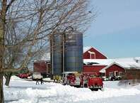 A tractor caught fire Thursday afternoon inside a barn at the Stuart Family Farm on Town Line Road in Bridgewater, Conn., Thursday, January 29, 2015.
