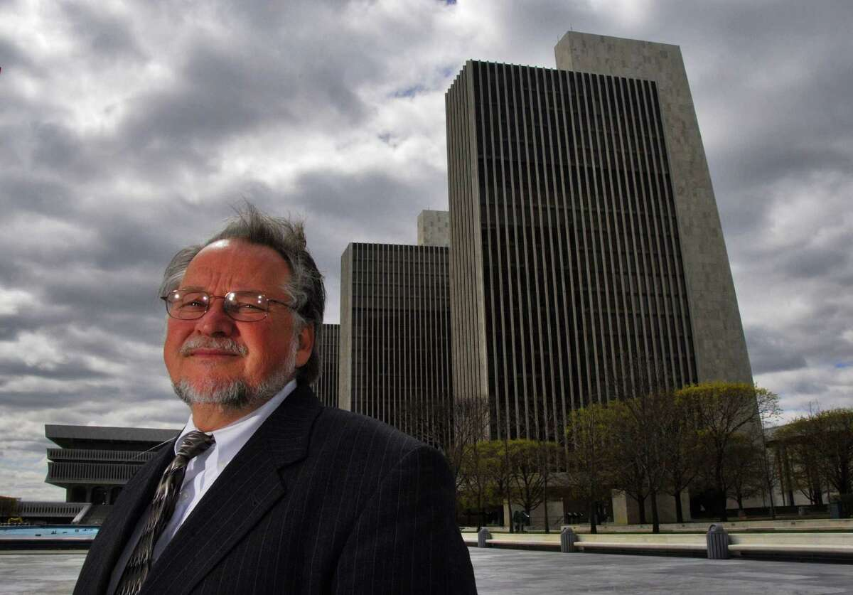 Times Union staff photo by John Carl D'Annibale: Jerry Norlander, head of the Public Utility Law Project, at the Empire State Plaza Monday April 17, 2006. At right is the Agency Building that houses the PSC. FOR RULISON STORY