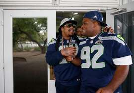 Seattle Seahawks Marshawn Lynch and Brandon Mebane arrive at a Super Bowl XLIX media availability session at the Arizona Grand Hotel on January 29, 2015 in Chandler, Arizona.  (Photo by Christian Petersen/Getty Images)