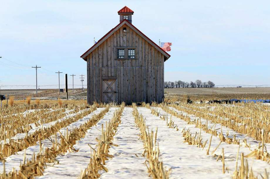 A barn called the Energy Barn, which was built by anti-pipeline activists directly on the route of the Keystone XL pipeline, stands in a snowy corn field near Bradshaw, Neb. The Senate passed legislation to authorize Keystone XL on Thursday. Photo: Nati Harnik /Associated Press / AP