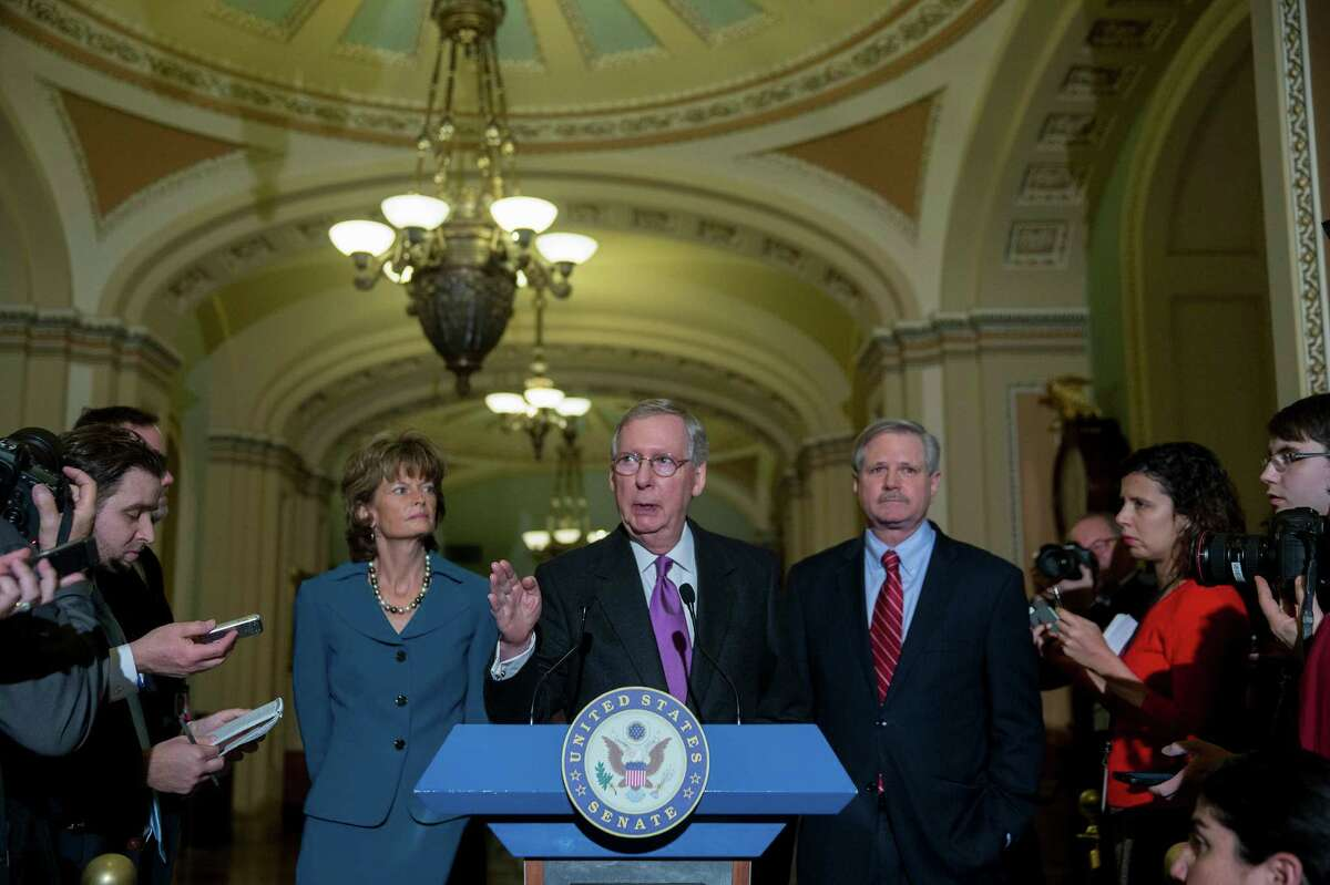 Senate Majority Leader Mitch McConnell (center), a Republican from Kentucky, speaks during a news conference with Sen. John Hoeven, a Republican from North Dakota, and Sen. Lisa Murkowski, a Republican from Alaska, after a cloture vote on the Keystone XL pipeline bill. Later Thursday, the Senate passed legislation to authorize Keystone XL on Thursday.