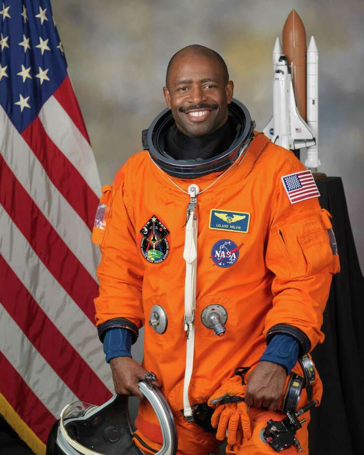 Leland Melvin's now-famous NASA portrait features his two rescue dogs, Jake and Scout, who he secretly smuggled into NASA for the photo shoot, per CNN. But this is his official NASA photo without the dogs. Photo: Robert Markowitz - NASA - JSC, NASA.gov