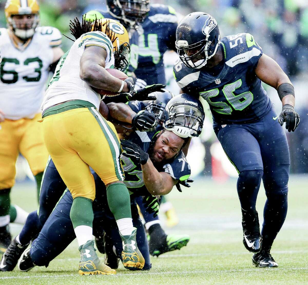 Seahawks defensive end Michael Bennett tackles Green Bay running back Eddie Lacy for a 2-yard loss in the fourth quarter the NFC championship game on Jan. 18, 2015, at CenturyLink Field in Seattle
