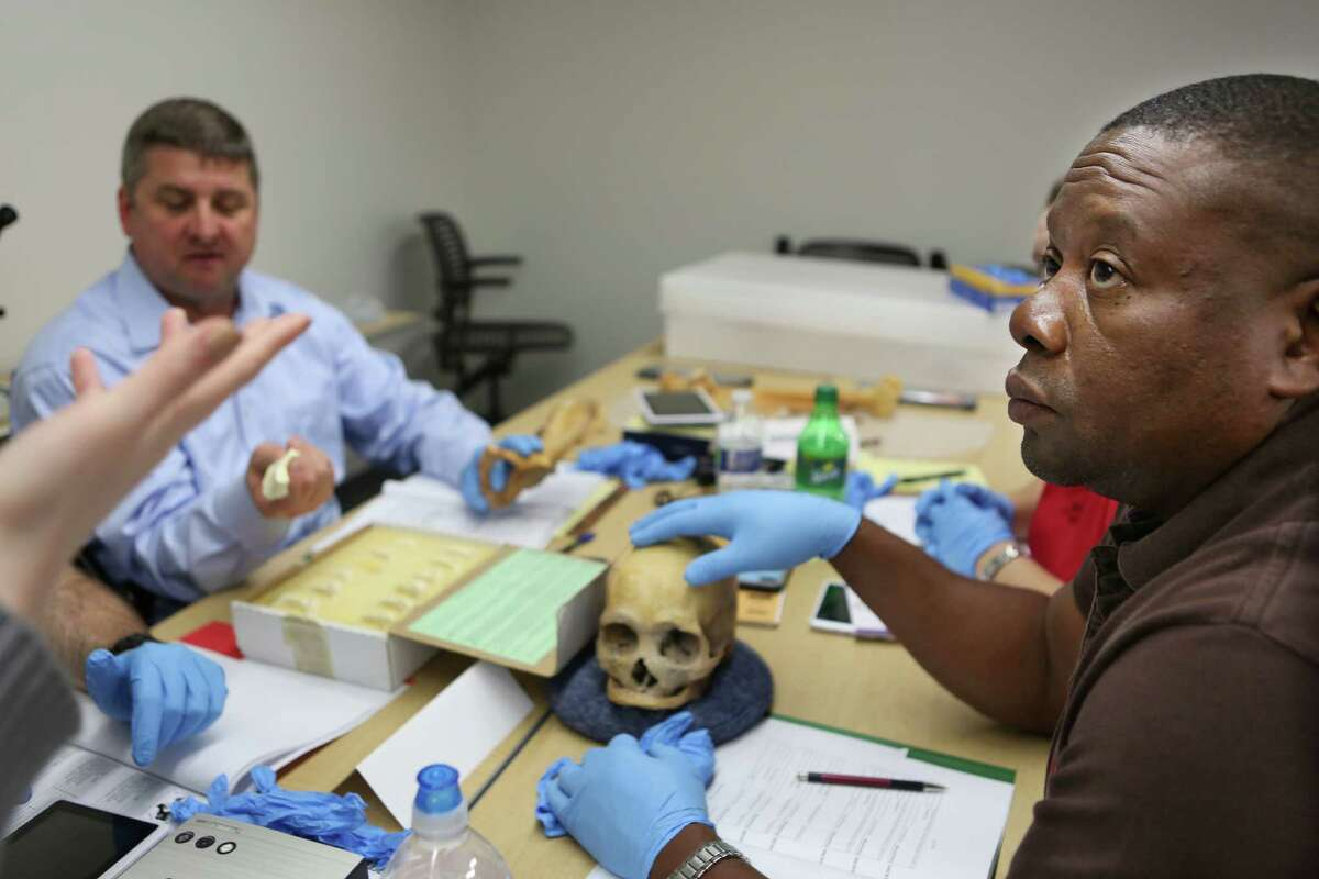 Weldon Richards, right, listens to instruction during the Southeast Texas Applied Forensic Science training session for the Montgomery County District Attorney's Office on forensic anthropology to help them better investigate and present cases involving human remains at Sam Houston State University satellite building in the Lone Star Campus on Thursday, Jan. 29, 2015, in The Woodlands.