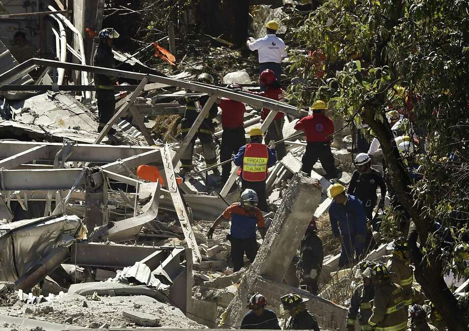 Rescuers work amid the rubble caused by an explosion Thursday at a maternity hospital in Mexico City's Cuajimalpa borough. The blast, caused by a propane gas leak, killed at least three people and injured more than 70, officials said. Photo: RONALDO SCHEMIDT, Staff / AFP