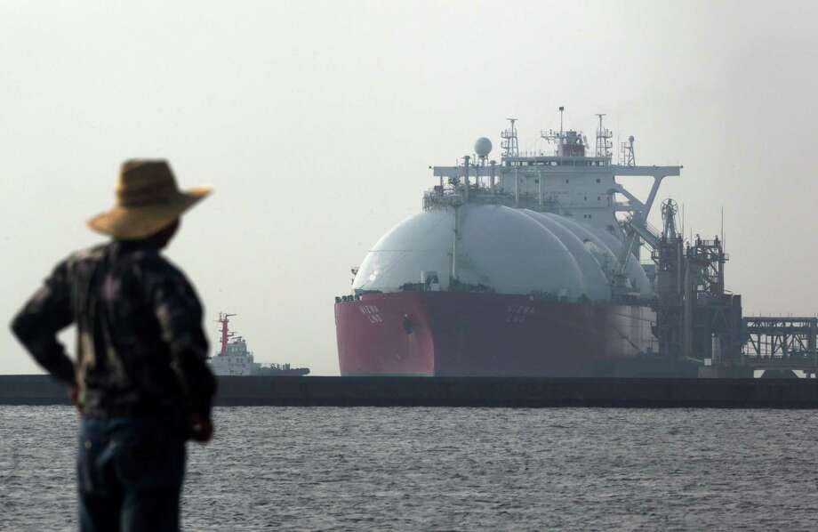 A liquefied natural gas tanker is berthed at a gas-fired thermal power plant in Futtsu, Japan. U.S. natural gas exports could struggle to compete with oil-linked LNG supplies in Asia. / © 2014 Bloomberg Finance LP