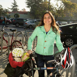 It is much more easy and pleasant to place goods in a basket attached to a bicycle than to haul them in a large backpack or messenger bag, as Mimi Torres shows during a visit to Trader Joe's.