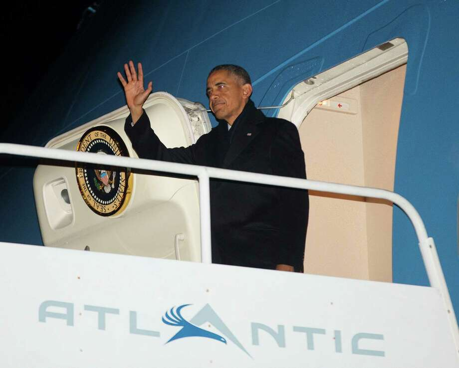 President Barack Obama waves during his arrival on Air Force One at Philadelphia International Airport, Thursday, Jan. 29, 2015, in Philadelphia. Obama traveled to Philadelphia and speak at the House Democratic Issues Conference. (AP Photo/Pablo Martinez Monsivais) Photo: Pablo Martinez Monsivais, STF / AP