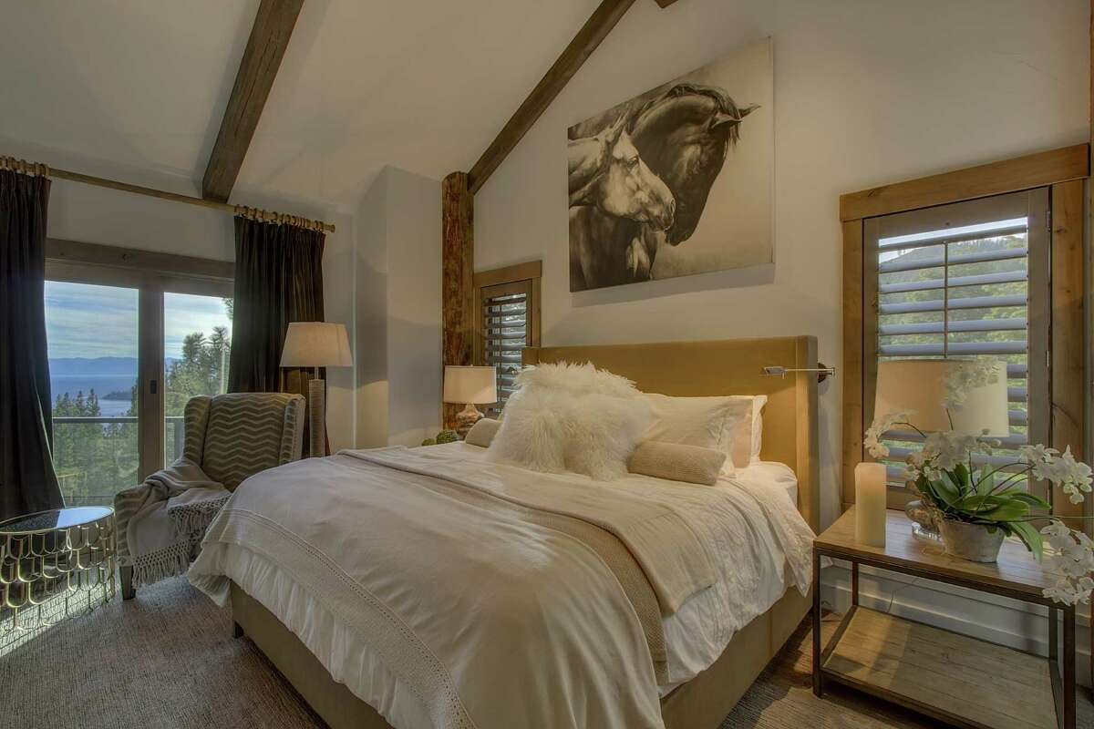 The master suite opens to a patio overlooking the verdant landscape.