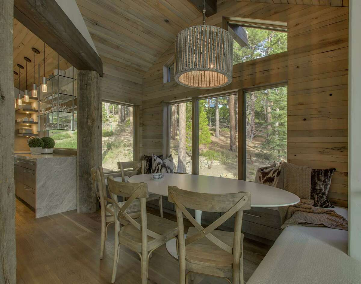 A breakfast nook off the kitchen includes a sitting bench.