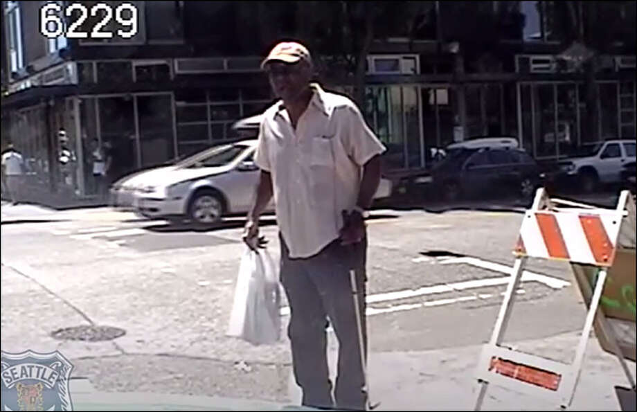 Dashcam video from an SPD patrol car shows William Wingate on a Seattle street corner.