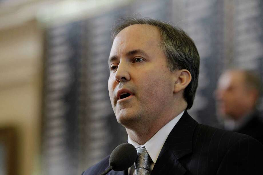 A gay former Conroe officer asked a judge to hold Attorney General Ken Paxton in contempt.  The U.S. Supreme Court recently approved gay marriage. Keep clicking to see photos of gay couples at the Harris County courthouse applying for licenses. Photo: Eric Gay, STF / AP2011