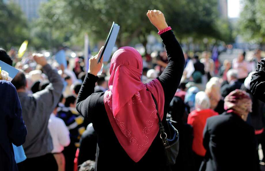 Participants cheer during a Texas Muslim Capitol Day rally, the seventh such event held in Austin, but the first met with angry protesters. Photo: Eric Gay, STF / AP