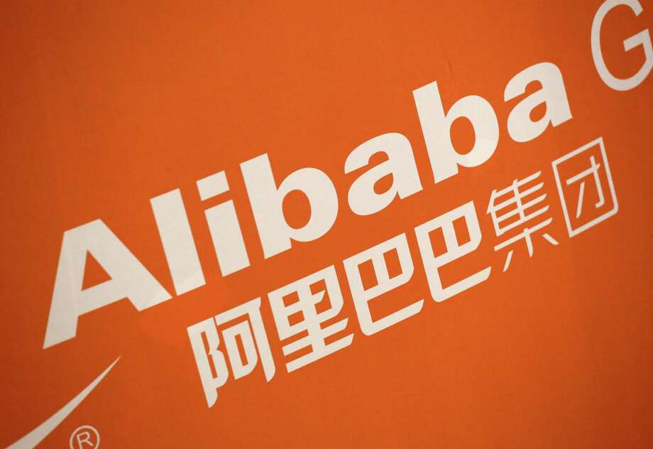 FILE - In this Sept. 19, 2014 file photo, the Alibaba logo is displayed during the company's IPO at the New York Stock Exchange, in New York. On Thursday, Jan. 29, 2015, Alibaba Group said its net income fell as it faced higher one-time costs but its adjusted earnings beat expectations. (AP Photo/Mark Lennihan, File) Photo: Mark Lennihan, STF / AP