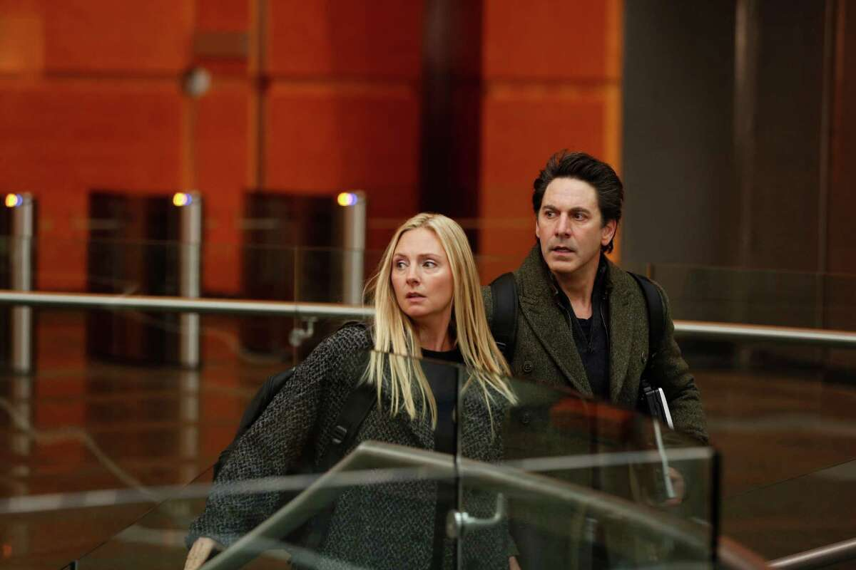 Hope Davis and Scott Cohen as Katya and Mark O'Connor, formerly spies for Russia, in