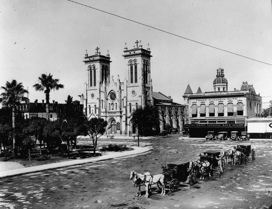 The old Frost National Bank Building sat next to San Fernando Cathedral downtown San Antonio in this 1914 photo. Photo: Courtesy Photo / Frost Bank