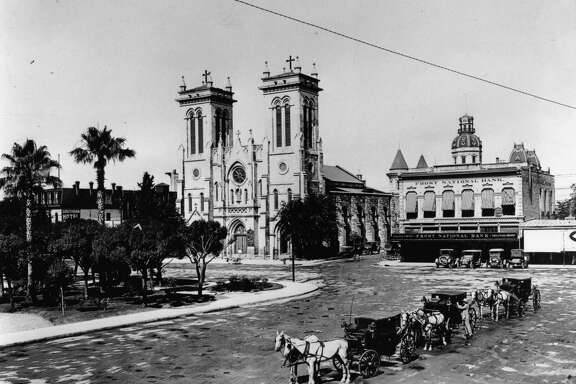 The old Frost National Bank Building sat next to San Fernando Cathedral downtown San Antonio in this 1914 photo.