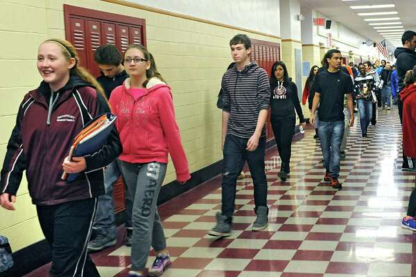 Students walk in the hallway between classes at Watervliet High School on Friday, Jan. 23, 2015 in Watervliet, N.Y. Watervliet is again in the top 10 districts in the state comptroller's school fiscal stress report. (Lori Van Buren / Times Union)