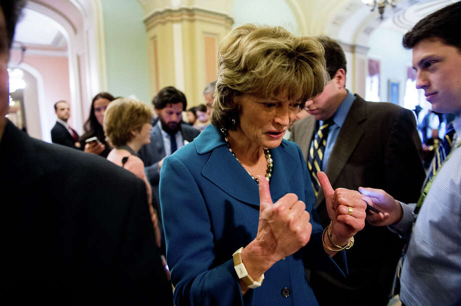 Sen. Lisa Murkowski, R-Alaska, gives thumbs up as she heads onto the Senate floor after speaking to members of the media following a procedural vote on the Keystone XL Pipeline bill at the U.S. Capitol Building on Thursday, Jan. 29, 2015 in Washington. Illustrates KEYSTONE (category A), by Paul Kane (c) 2015, The Washington Post. Moved Thursday, Jan. 29, 2015. (MUST CREDIT: Photo for The Washington Post by Andrew Harnik) Photo: Andrew Harnik, STR / Andrew Harnik