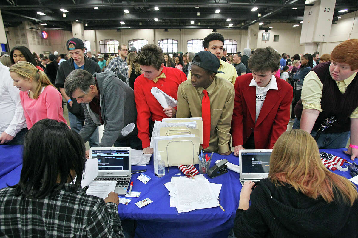 """A long line conquered, registrants reach the sign in table as """"America's Got Talent"""" hopefuls await their turn for an audition at the Convention Center."""