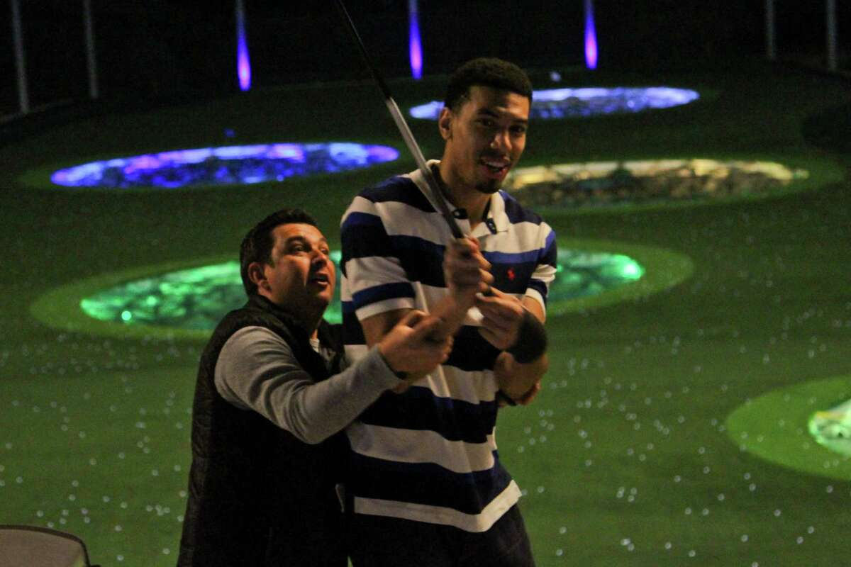 Spurs player Danny Green works on his golf swing Thursday during Topgolf's opening celebration of its first location in San Antonio.