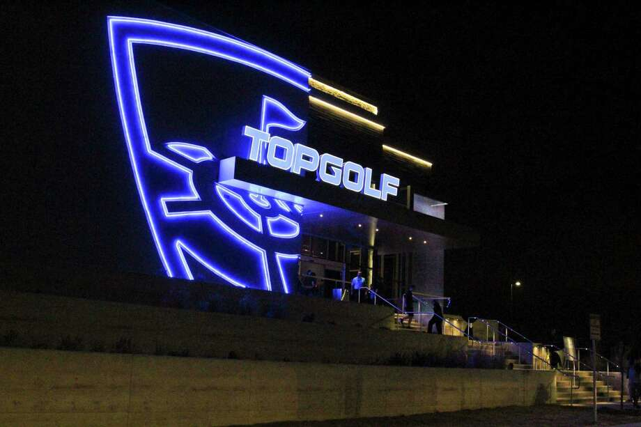 Topgolf opens its first location in San Antonio Friday, Jan. 30. Guests can get a fun golfing experience, as well as chow down on delicious food and alcoholic beverages. Photo: Tyler White