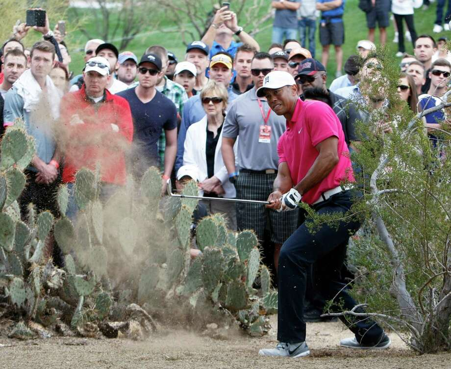It was a rough day for Tiger Woods, who shot a 2-over-par 73 in the first round of the Phoenix Open. Photo: Rick Scuteri, FRE / FR157181 AP