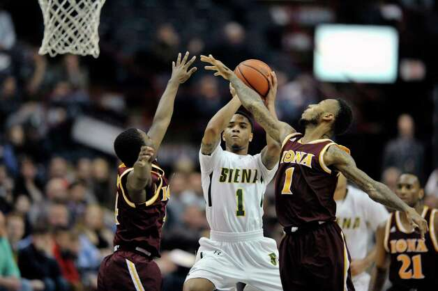 Marquis Wright of Siena, center, drives the lane and puts up a shot during their game against Iona at the Times Union Center on Sunday, Jan. 4, 2014, in Albany, N.Y.   (Paul Buckowski / Times Union) Photo: Paul Buckowski / 00030029A