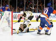 UNIONDALE, NY - JANUARY 29:  Tuukka Rask #40 of the Boston Bruins makes a save against the New York Islanders during their game at the Nassau Veterans Memorial Coliseum on January 29, 2015 in Uniondale, New York.  (Photo by Al Bello/Getty Images) ORG XMIT: 507049147