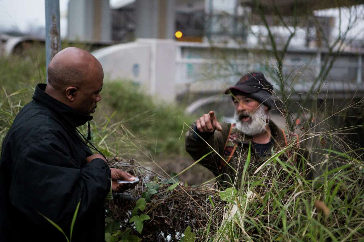 Ron Brown of Haven for Hope talks to Ricky Miller, 51, about the homeless count being conducted in San Antonio, TX on Thursday, January 29, 2015. Miller has been homeless for 3 years.