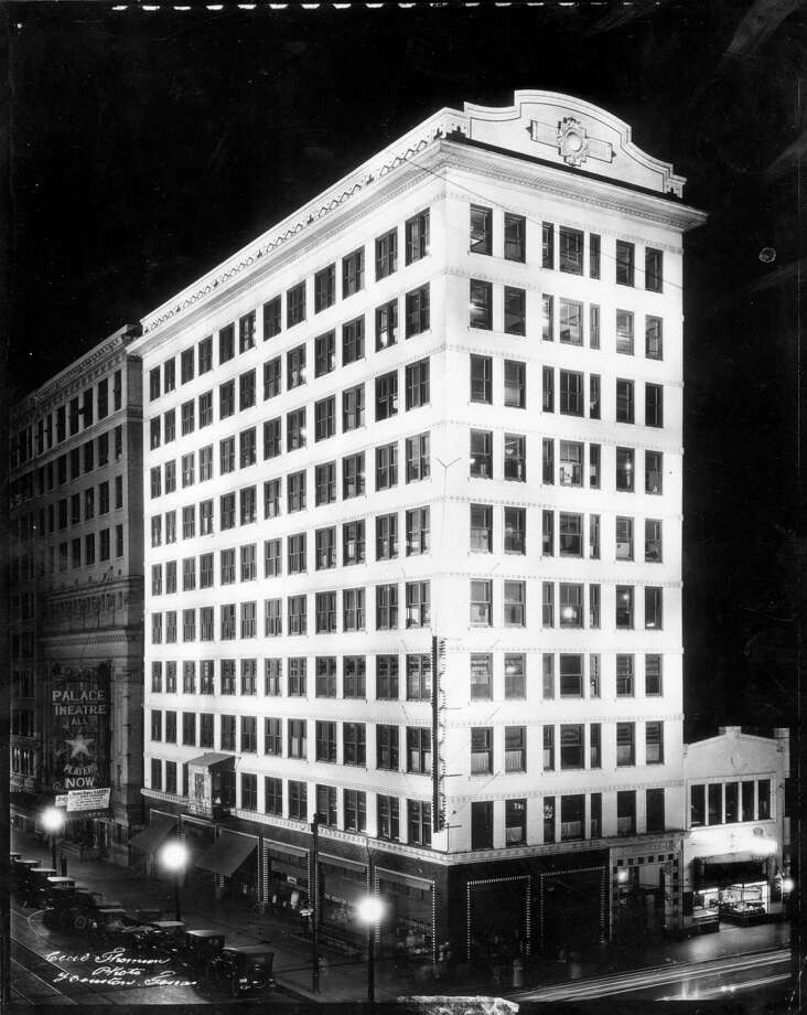 From Oct. 30, 1966 watchem: Chronicle building, early 1920s. That box along the side of the building served a vital purpose in pre-radio days. Telegraph operators recorded play-by-play progress of World Series and Texas League games and the plays were indicated on the scoreboard by posting figures and indicating base runners by a series of lights on a diagram of the baseball diamond. Baseball fans confined to downtown offices often sent relays of office boys to watch the scoreboard and bring back news of inning standings. Crowds often blocked Texas Avenue during the series. It was also used to post political results on election night. Advent of play-by-play broadcasting ended its usefulness. Photo: CECIL THOMSON / FREELANCE
