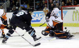 Sharks wing Joe Pavelski fires a shot past Ducks goalie Ilya Bryzgalov for his 25th goal to get his team on the board in the first period. Pavelski's strike tied him for the NHL lead with 13 power-play goals.