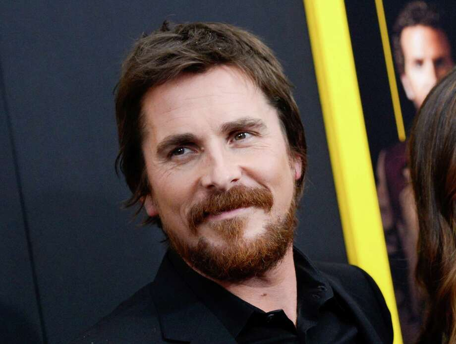 """FILE - This Dec. 8, 2013 file photo shows actor Christian Bale at the premiere of """"American Hustle"""" at the Ziegfeld Theatre in New York. Bale was nominated for a Golden Globe for best actor in a motion picture musical or comedy for his role in the film on Thursday, Dec. 12, 2013.  The 71st annual Golden Globes will air on Sunday, Jan. 12. (Photo by Evan Agostini/Invision/AP, File) ORG XMIT: NYET747 Photo: Evan Agostini / Invision"""