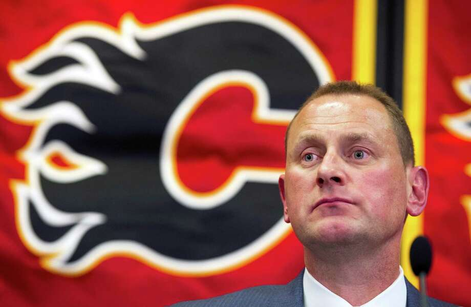 Calgary Flames' new General Manager Brad Treliving speaks at a press conference after being introduced in Calgary, Alberta, on Monday, April 28, 2014. Treliving spent the past seven seasons as an assistant under general manager Don Maloney, helping guide the Phoenix Coyotes.  (AP Photo/The Canadian Press, Larry MacDougal) ORG XMIT: LMD107 Photo: Larry MacDougal / CP
