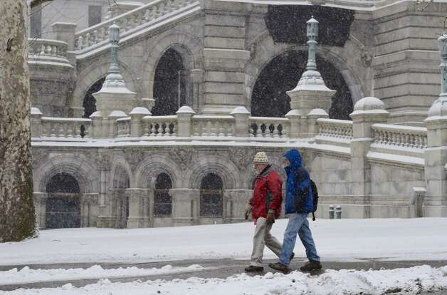 Snow covers ledges at the state Capitol on Friday, Jan. 30, 2015. The morning's moderate temperatures and light snow are expected to give way to frigid temperatures and stiff wind overnight. (Skip Dickstein / Times Union)