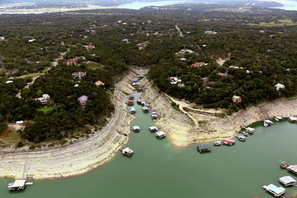 This June 4, 2014 aerial photograph provided by the Lower Colorado River Authority (LCRA) shows Lake Travis, Texas. Another river authority in Jackson County on Nov. 18, 2015 asked Attorney General Ken Paxton if it could continue to ban handguns in its parks after a slew of new gun laws were passed this year. (AP Photo/Lower Colorado River Authority)