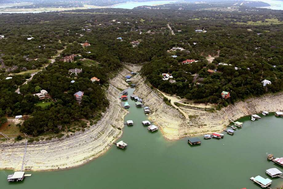 This June 4, 2014 aerial photograph provided by the Lower Colorado River Authority (LCRA) shows Lake Travis, Texas. Another river authority in Jackson County on Nov. 18, 2015 asked Attorney General Ken Paxton if it could continue to ban handguns in its parks after a slew of new gun laws were passed this year. (AP Photo/Lower Colorado River Authority) Photo: Dylan Baddour / Lower Colorado River Authority