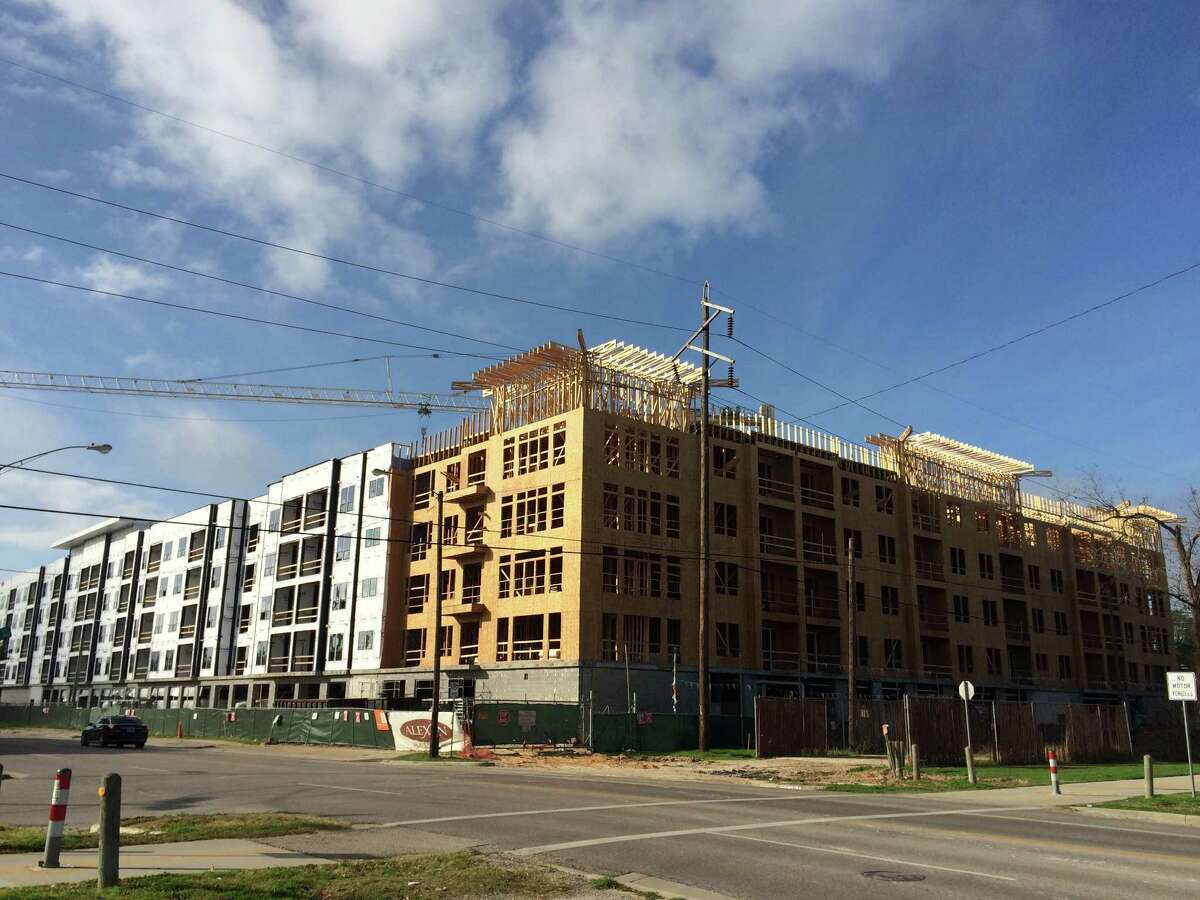 Alexan Heights is an upscale apartment complex under construction at Yale and 6th streets. Trammell Crow Co. is the developer.