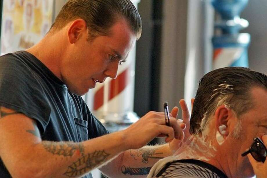 Big Kat's Barbershop & Shave Parlor, in Houston's Midtown, is one of the stylish new breed of barbershops. Photo: Big Kat's Barbershop