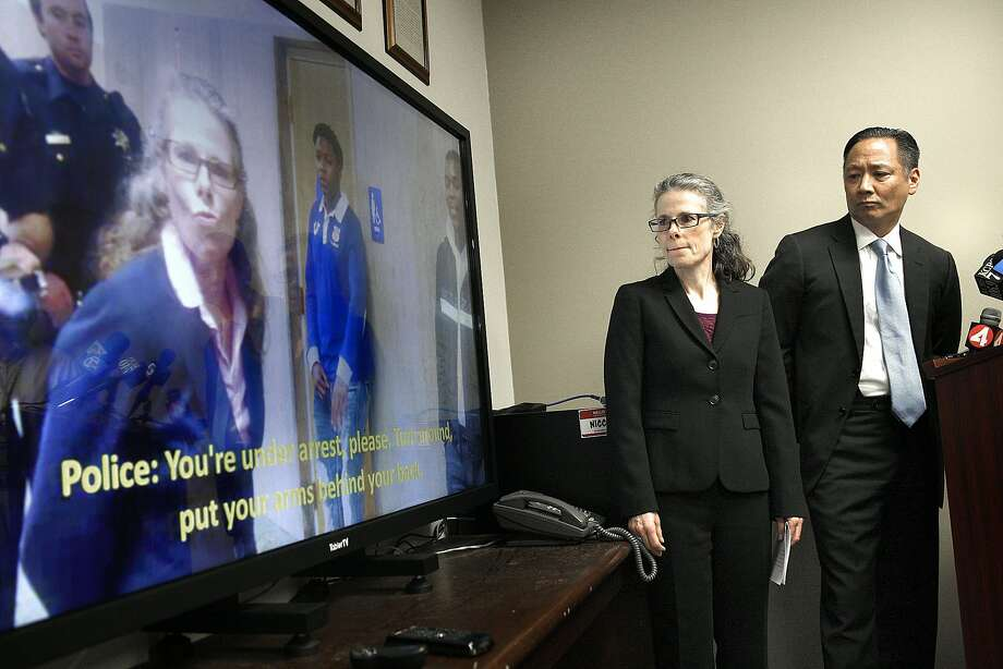 Attorney Jami Tillotson (left) watches video shown during a press conference with public defender Jeff Adachi  (right) in San Francisco, Calif., on Wednesday, January 28, 2015.  Attorney Jami Tillotson was arrested at the Hall of Justice at 850 Bryant St. for an hour yesterday while trying to question a client outside of the courtroom. Photo: Liz Hafalia, The Chronicle