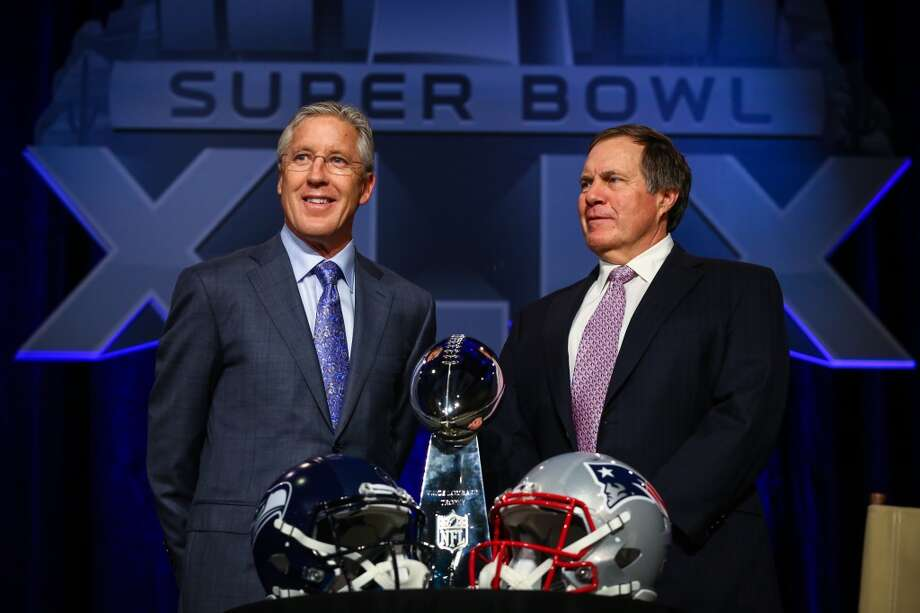 Seattle Seahawks head coach Pete Caroll and Patriots head coach Bill Belichick speak to the press on Friday, January 30, 2015, at the Phoenix Convention Center in Arizona. Photo: JOSHUA TRUJILLO, SEATTLEPI.COM