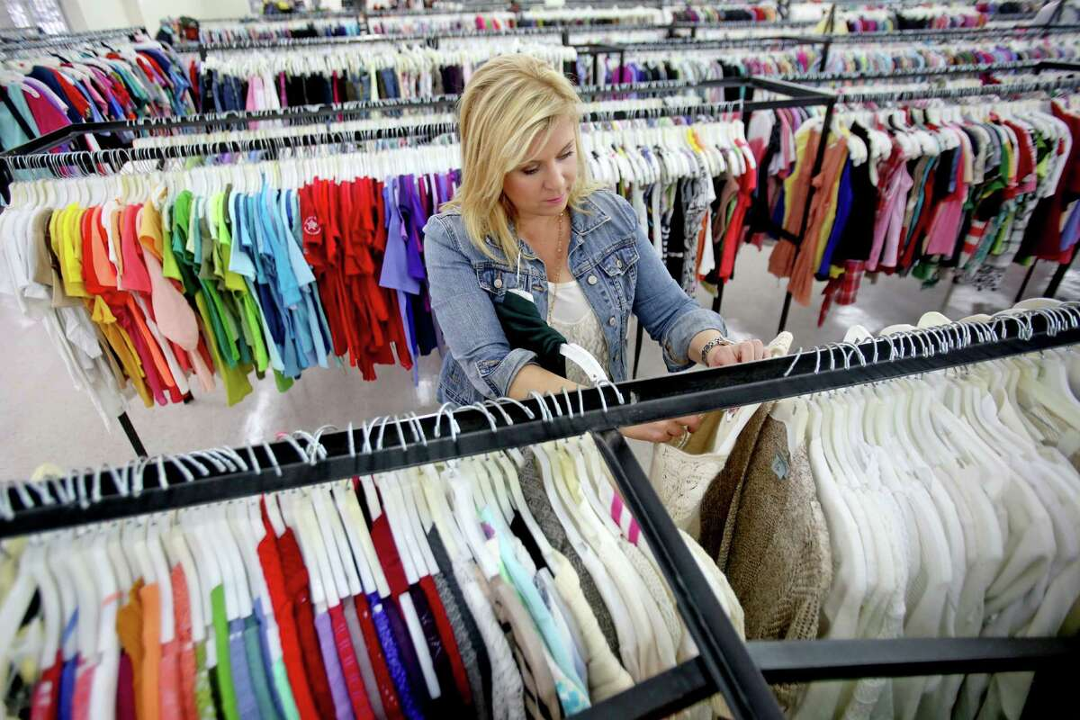 Don't be in a hurry; you will need time to browse through entire store.Pippa Williams, one half of the duo known as Too Cheap Blondes, hunts for designer-brand clothes at Family Thrift Outlet Store. Items at the outlet sell for $2 each.