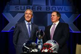 Seattle Seahawks head coach Pete Caroll and Patriots head coach Bill Belichick speak to the press on Friday, January 30, 2015, at the Phoenix Convention Center in Arizona.