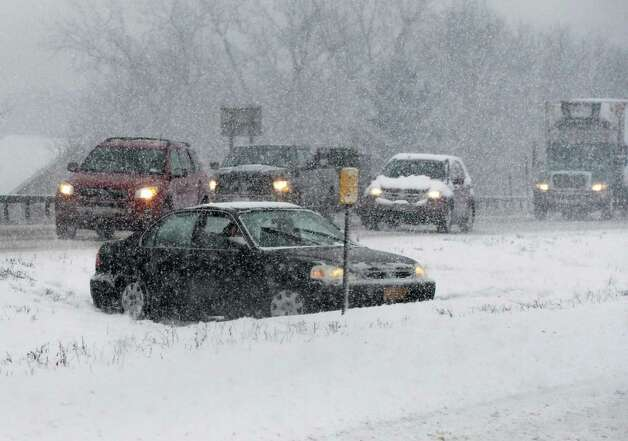 A car off the road on the median of alternate Rt. 7 Friday Jan. 30, 2014, in Colonie, NY.  (John Carl D'Annibale / Times Union) Photo: John Carl D'Annibale