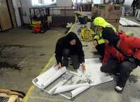 George dePiro, right, co-owner of Druthers Brewing brew pub, looks over brewing equipment schematics with Zach Weber, left, and Travis Leon of Mark's Design & Metalworks on Friday Jan. 30, 2015 in Albany, N.Y. (Michael P. Farrell/Times Union)