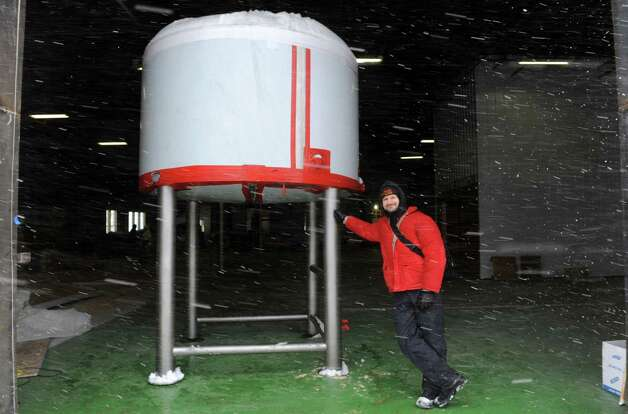 George dePiro co-owner of Druthers Brewing brew pub, stands with a new brewing tank on Friday Jan. 30, 2015 in Albany, N.Y. (Michael P. Farrell/Times Union) Photo: Michael P. Farrell / 00030400A