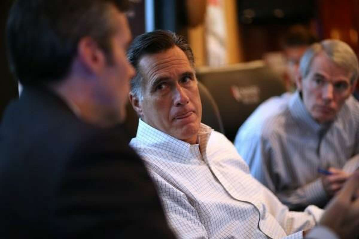 Mitt Romney during 2012 campaign, sitting with Sen. Rob Portman, R-Ohio. The fomer Republican standard-bearer marched with protesters in Washington, D.C, on Sunday, and spoke the words