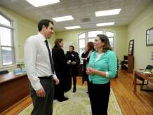 Luigi Fulinello, left, economic developement director for the town of New Milford, Conn., and Julie Wechter, administrative assistant, chat together at an open house for the new home base of the New Milford Economic Developement Commission on Bank Street in New Milford, Thursday, January 30, 2015.