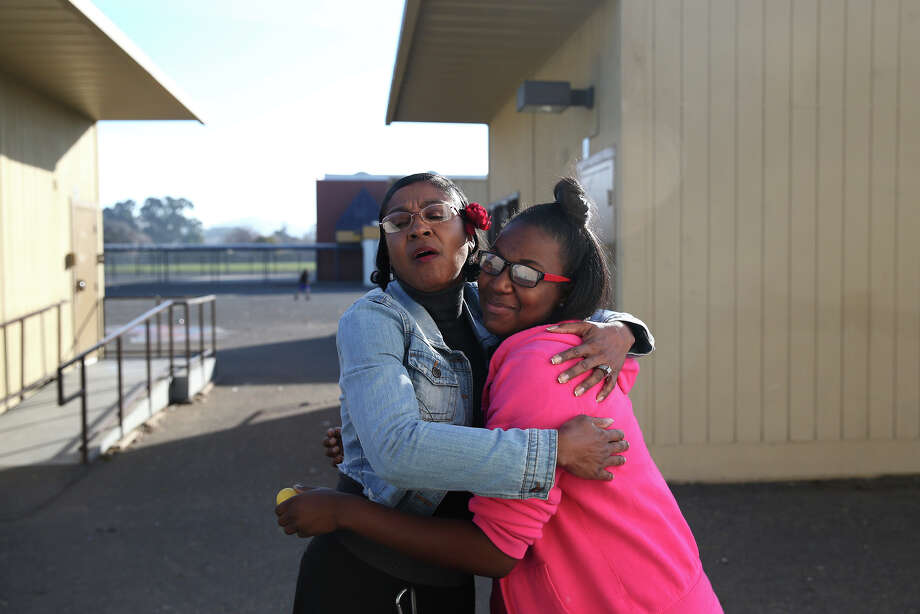 Madison Park Business and Art Academy principal Lucinda Taylor (left) embraces 10th-grader Ke'Avionne White in Oakland. Photo: Paul Chinn / The Chronicle / ONLINE_YES