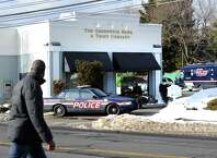 Greenwich Police investigate a bank robbery that occurred around noon at the Greenwich Bank and Trust at 1103 East Putnam Ave. in the Riverside section of Greenwich, Conn., Friday, Jan. 30, 2015.
